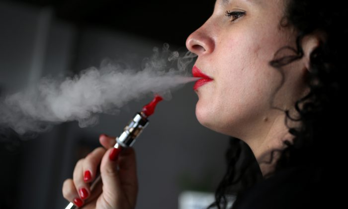Julia Boyle enjoys an electronic cigarette at the Vapor Shark store on February 20, 2014 in Miami, Florida. (Joe Raedle/Getty Images)