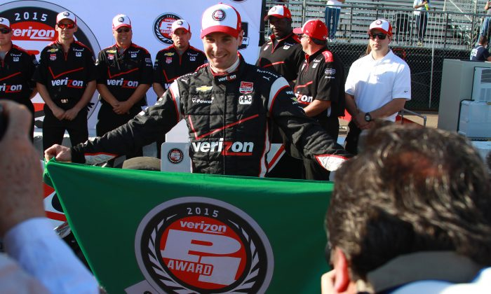 Penske Racing driver Will Power proudly displays the banner signifying him winning his fifth pole for the IndyCar St. Pete Grand Prix in six years. (Chris Jasurek/Epoch Times)