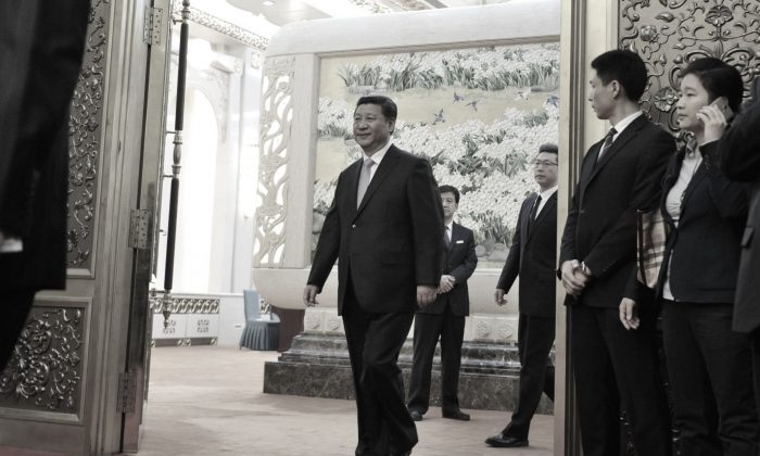 Chinese regime leader Xi Jinping greeted guests on March 27 at the Great Hall of the People in Beijing, in the days leading to the Boao Forum. (Parker Song-Pool/Getty Images)