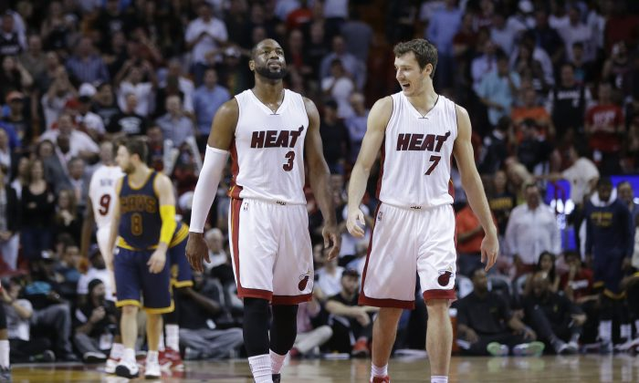 Miami Heat's Dwyane Wade (3) and Goran Dragic (7) walk on the court during the second half of an NBA basketball game against the Cleveland Cavaliers, Monday, March 16, 2015, in Miami. The Heat defeated the Cavaliers 106-92. (AP Photo/Lynne Sladky)