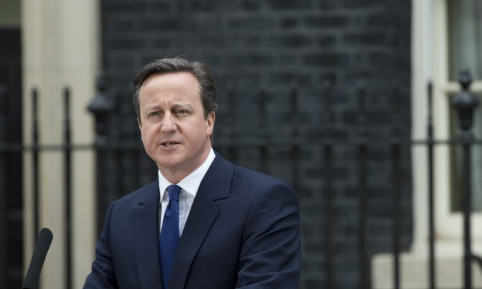 British Prime Minister David Cameron makes a speech outside 10 Downing Street in London, after arriving back from visiting Britain's Queen Elizabeth II, Monday, March 30, 2015. (AP Photo/Alastair Grant)