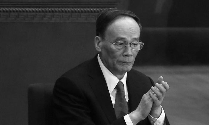 Wang Qishan, secretary of the Central Commission for Discipline Inspection is at the Great Hall of People on March 3, 2015. (Feng Li/Getty Images)