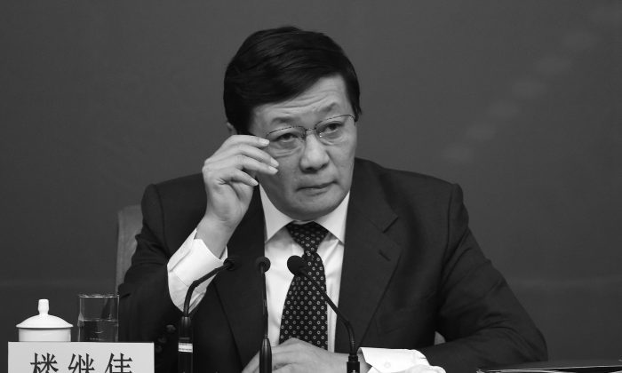 Chinese Finance Minister Lou Jiwei attends National People's Congress on March 5, 2015. (Wang Zhao/AFP/Getty Image)