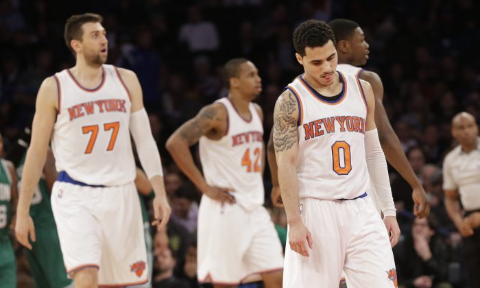 New York Knicks guard Shane Larkin reacts after a foul was called against the Knick during the second half of an NBA basketball game Boston Celtics, Friday, March 27, 2015, at Madison Square Garden in New York. The Celtics won 96-92. (AP Photo/Mary Altaffer)