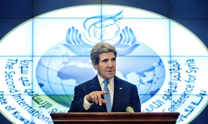 US Secretary of State John Kerry speaks during a news conference at Syria Donors' Conference at the Bayan Palace in Kuwait, Wednesday, Jan. 15, 2014. (AP Photo/Pablo Martinez Monsivais)