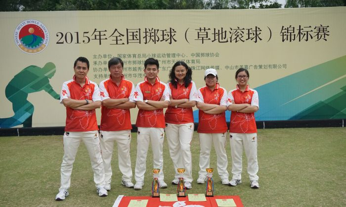 PRIDE OF HONG KONG – The Hong Kong lawn bowls team proudly displays the three trophies they won at the 3rd Chinese National Lawn Bowls Championship in Guangzhou on March 28, 2015. Team members include (from L): Claudius Lam (manager), Timmy Kwong, Ken KK Chan, Helen Cheung, Vivian Yip, and Amy Choi (manageress).  (Cyril Leung)