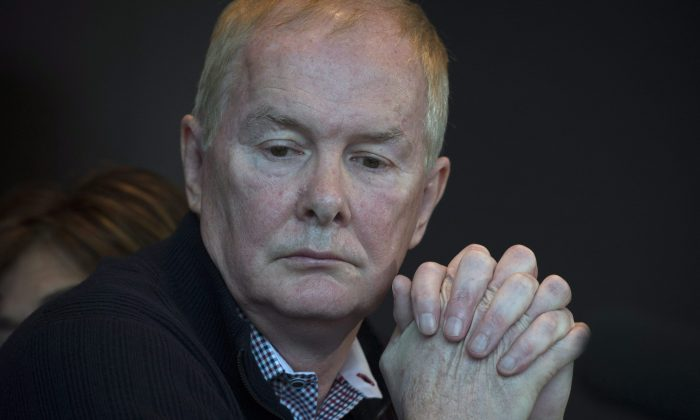 Former Vancouver Olympics CEO John Furlong pauses for a moment while addressing the media from his lawyer's office in Vancouver on March 31, 2015. Furlong says he has been vindicated by the courts after the last of three sexual abuse lawsuits was thrown out on March 30, 2015. (The Canadian Press/Jonathan Hayward)