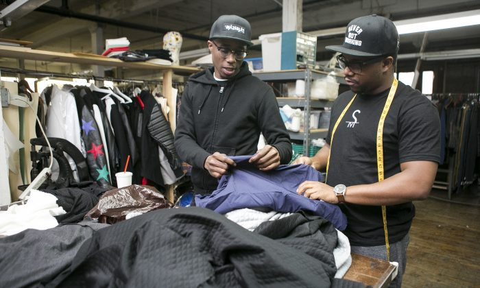 Clinton Ballard (L) and John Oliver, co-founders of Brooklyn Alchemist Station, at their clothing factory in Brooklyn on March 1, 2015. Their startup makes it easier for small designers to manufacture products in the U.S. (Samira Bouaou/Epoch Times)