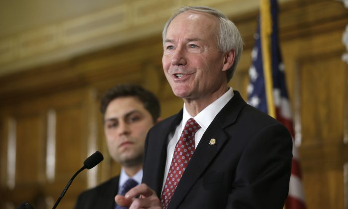 Arkansas Gov. Asa Hutchinson answers reporters' questions at the state Capitol in Little Rock, Ark. on April 1, 2015. (Danny Johnston/AP Photo)