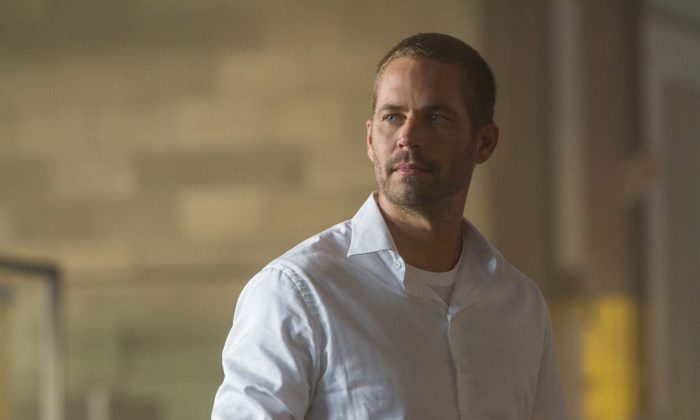 "The late Paul Walker stars as Brian O'Conner in ""Furious 7"" (Scott Garfield/Universal Studios)"