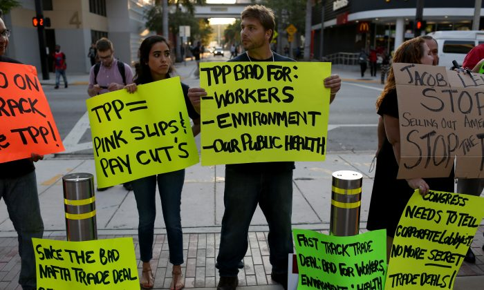 Protesters against the TPP, outside Miami Dade College, where the Greater Miami Chamber of Commerce and the college were hosting a moderated conversation with U.S. Secretary of the Treasury Jacob Lew on March 20, 2015. (Joe Raedle/Getty Images)