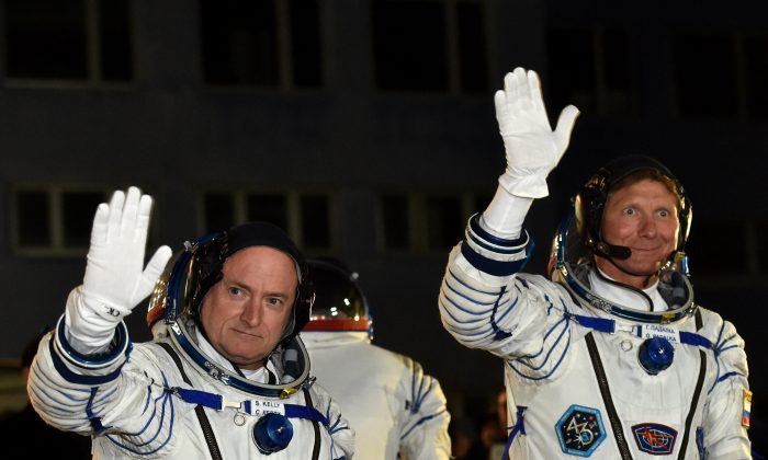 The international crew of US astronaut Scott Kelly and Russian cosmonauts Gennady Padalka and Mikhail Kornienko is scheduled to blast off to the ISS from Baikonur early on March 28. AFP PHOTO / KIRILL KUDRYAVTSEV (KIRILL KUDRYAVTSEV/AFP/Getty Images)