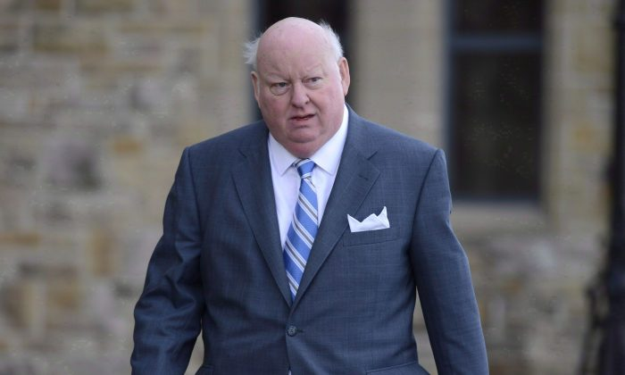 Sen. Mike Duffy arrives at the Senate on Oct. 28, 2013. When lawyers arrive at the Ottawa courthouse for the long-awaited start of Duffy's trial on April 7, 2015, they'll be armed with the equivalent of advanced degrees in the rules governing Senate expenses. (The Canadian Press/Adrian Wyld)