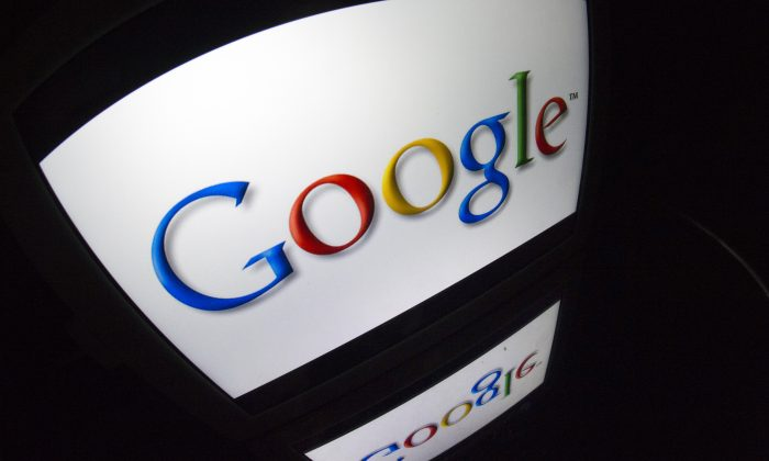"The ""Google"" logo is seen on a tablet screen on Dec. 4, 2012. Google is banning security certificate issued by a Chinese Internet authority. (Lionel Bonaventure/AFP/Getty Images)"