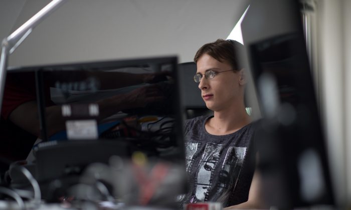 In this file photo, Melanie Altrock, 27-year autistic programmer employed at the company Auticon sits at her workplace on May 30, 2013 in Berlin. (Johannes Eisele/AFP/Getty Images)