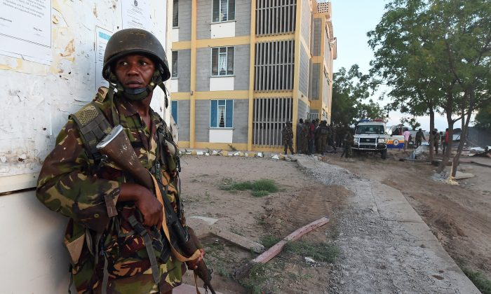 A member of the Kenyan Defence Forces stands guard at the Garissa University campus after an attack by Somalia's Al-Qaeda-linked Shebab gunmen in Garissa on April 2, 2015. At least 70 students were massacred when Somalia's Shebab Islamist group attacked a Kenyan university today, the interior minister said, the deadliest attack in the country since US embassy bombings in 1998.  AFP PHOTO / CARL DE SOUZA        (Photo credit should read CARL DE SOUZA/AFP/Getty Images)