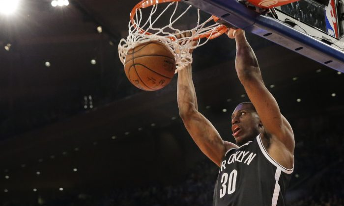 Brooklyn Nets forward Thaddeus Young dunks during the first half of an NBA basketball game New York Knicks, Wednesday, April 1, 2015, at Madison Square Garden in New York. (AP Photo/Mary Altaffer)