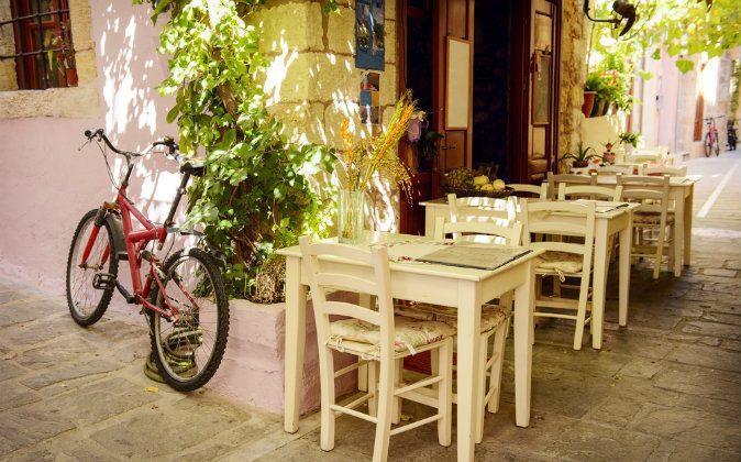 Street cafe in Greek town via Shutterstock*