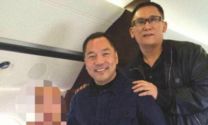An undated photo posted on a Chinese microblog on March 23, 2015, shows Beijing Zenith's Guo Wengui (left) and Founder Group's Li You on a private jet. (Weibo)