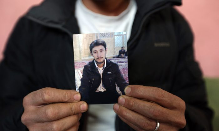 Mohammad Zahir, a Hazara man abducted in February, holds a photograph of his brother during an interview with The Associated Press in Kabul, Afghanistan, Saturday, April, 4, 2015.  (AP Photo/Rahmat Gul)
