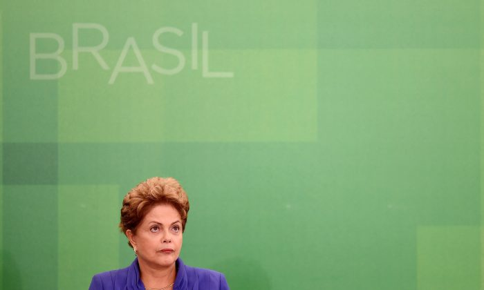 Brazilian President Dilma Rousseff attends a ceremony to announce a package of anti-corruption bills, at the presidential palace in Brasilia, on March 18, 2015. (Evaristo Sa/AFP/Getty Images)