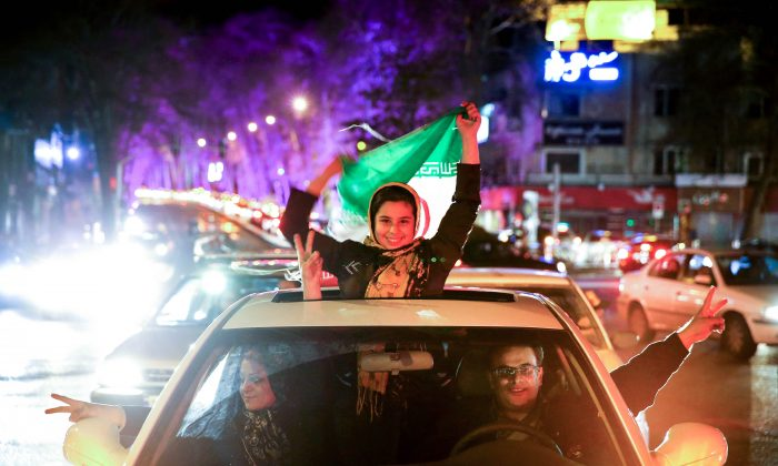 Jubilation in the streets of Tehran after news of the deal which means sanctions will be lifted. (AP Photo/Ebrahim Noroozi)