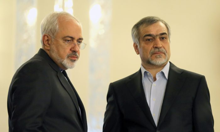 Iranian Foreign Minister Javad Zarif (L) and Hossein Fereydoun, President Rouhani's younger brother and adviser, look on during a press conference of President Hassan Rouhani (unseen) in Tehran on April 3, 2015. (Atta Kenare/AFP/Getty Images)