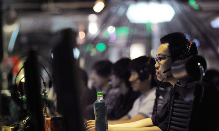 A May 12, 2011, file photo shows people at an internet cafe in Beijing. China turns 10 million students into online propagandists. (Gou Yige/AFP/Getty Images)