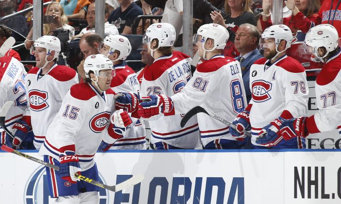 Montreal Canadiens' P.A. Parenteau is congratulated by teammates after scoring a second-period goal against the Florida Panthers on April 5, 2015 in Sunrise, Florida. (Joel Auerbach/Getty Images)