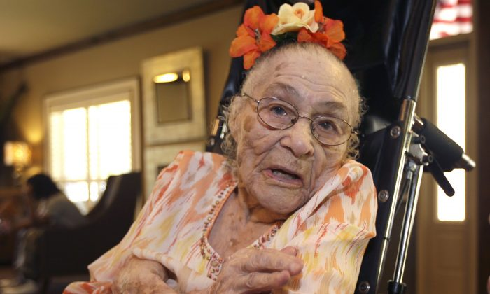 FILE - In this Thursday, July 3, 2014, file photo, Gertrude Weaver poses at Silver Oaks Health and Rehabilitation Center in Camden, Ark., a day before her 116th birthday. With the death of a 117-year-old woman in Japan, Weaver became the world's oldest person, according to the Los Angeles-based Gerontology Research Group, which tracks supercentenarians. (AP Photo/Danny Johnston, File)