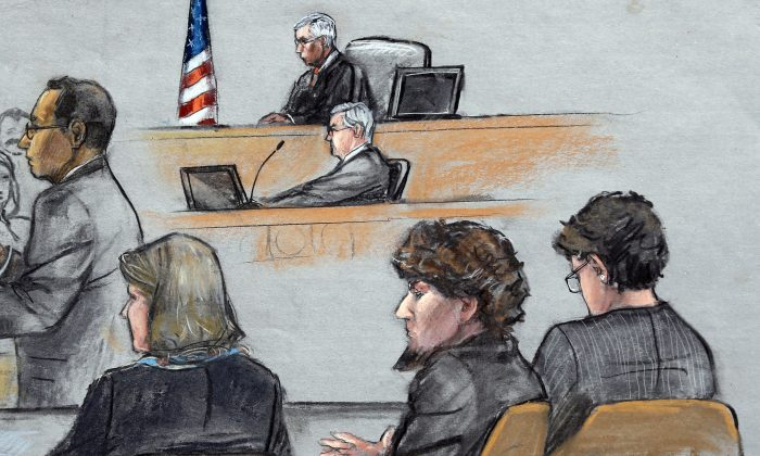 Assistant U.S. Attorney Aloke Chakravarty, left, is depicted addressing the jury as defendant Dzhokhar Tsarnaev, second from right, sits between his defense attorneys during closing arguments in Tsarnaev's federal death penalty trial Monday, April 6, 2015, in Boston. Tsarnaev is charged with conspiring with his brother to place two bombs near the Boston Marathon finish line in April 2013, killing three and injuring 260 people. (AP/Jane Flavell Collins)