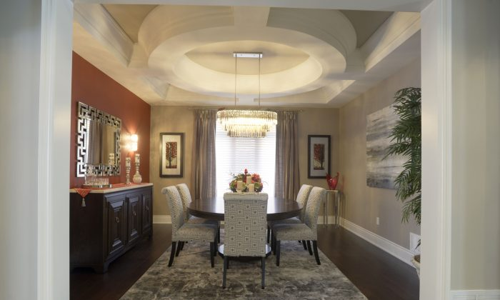 The dining room in North Star's model home of its Chateau Collection, which boasts high-pitched rooflines, turret rooms, and sweeping staircases. (North Star Homes)