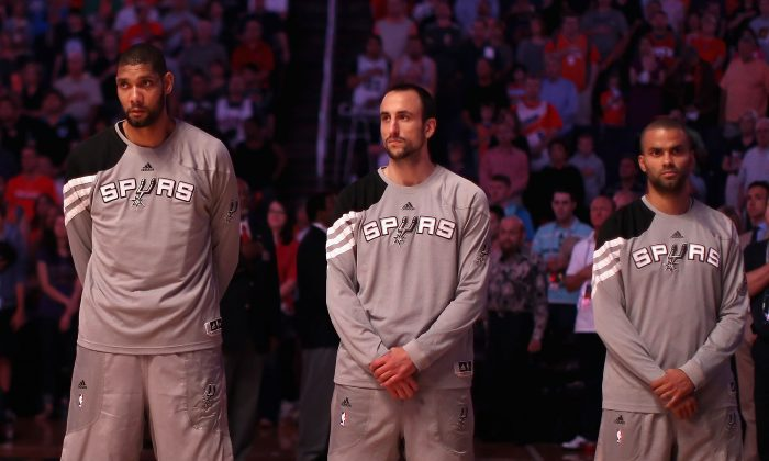 Tim Duncan (L), Manu Ginobili (C), and Tony Parker of the San Antonio Spurs have played more games together than any trio in NBA history. (Christian Petersen/Getty Images)