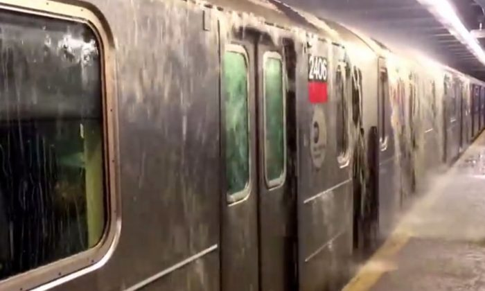 The subway station in Greenwich Village was flooded due to a water break, according to reports. (Screenshot / YouTube video)