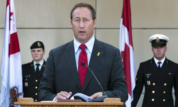 Former Defence Minister Peter MacKay announces increased spending on mental health care programs at a news conference in Halifax on Sept. 12, 2012. New documents show the Canadian military has found recruiting new psychiatrists, psychologists, and social workers to be an uphill battle. (The Canadian Press/Andrew Vaughan)