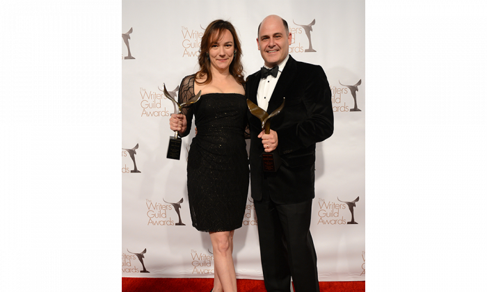 "Writers Semi Chellas and Matthew Weiner pose with their Writers Guild of America episodic drama award for ""Mad Men"" at the JW Marriott hotel in Los Angeles on Feb. 17, 2013. (Jason Kempin/Getty Images)"