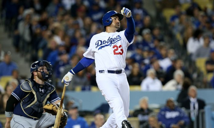 Adrian Gonzalez of the Los Angeles Dodgers hits his third home run of the game, and fifth of the season, against the San Diego Padres at Dodger Stadium on April 8, 2015 in Los Angeles, California (Photo by Stephen Dunn/Getty Images)