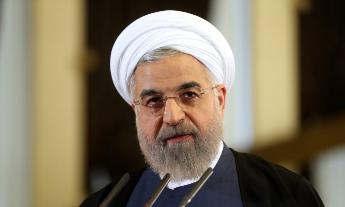Iranian President Hassan Rouhani speaks in a news briefing at the Saadabad palace in Tehran, Iran, on April 3, 2015. (AP Photo/Ebrahim Noroozi)