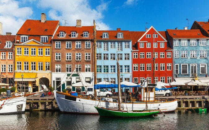 Scenic summer view of color buildings of Nyhavn in Copehnagen via Shutterstock*