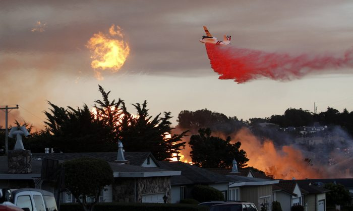 "In this Sept. 9, 2010, file photo, a massive fire following a pipeline explosion roars through a mostly residential neighborhood in San Bruno, Calif. Repeated natural-gas accidents including a pipeline explosion that killed eight people suggest that Pacific Gas & Electric Co., California's largest power utility, may be too big to operate safely, the state's top utility regulator says. California Public Utilities Commission President Michael Picker said he would ask the commission's staff to study ""the culture of safety"" and the structure of the utility, which he noted currently has its gas and electricity operations under a single board and CEO. PG&E is one of the country's largest power utilities with 9.7 million gas and electric customers. The Associated Press obtained Picker's prepared statement ahead of a commission meeting Thursday, April 9, 2015, where the panel is expected to vote on a record $1.6 billion penalty for the 2010 PG&E gas pipeline explosion in a San Francisco suburb. (AP Photo/Jeff Chiu, File)  http://www.apexchange.com/GetContent.aspx?id=25fd76a2f1ae4cff9ff405af047d77a7&links=&fid=d8b2d374a8e94cc29077979a7701689c&Token=&media=Text&slug=BC-US--Gas%20Pipeline%20Explosion,1st%20Ld-Writethru&format=nitf&site=1"