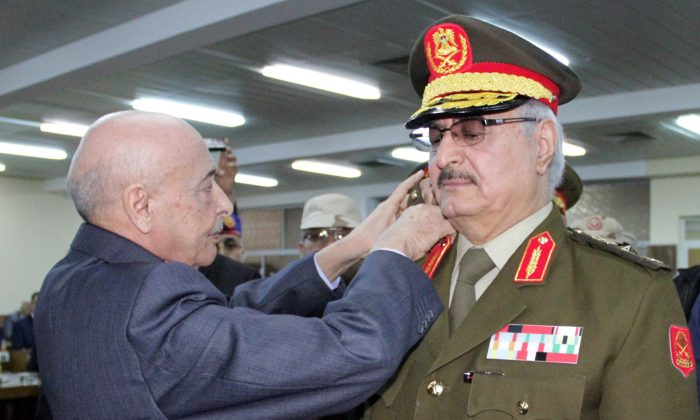 Anti-Islamist Gen. Khalifa Haftar (R) during his swearing-in ceremony as the new army chief in Libya, in the eastern city of Tobruk, on March 9, 2015. (STR/AFP/Getty Images)