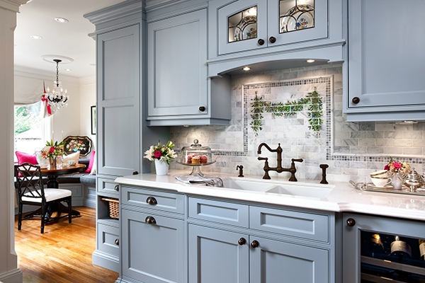 Craftspeople combined skills to create an English country kitchen in this Tudor-style home. (Brandon Barre)