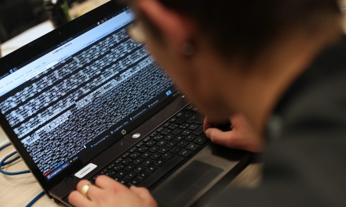 A student from an engineering school attends the first edition of the Steria Hacking Challenge., in Meudon, west of Paris, March 16, 2013. (Thomas Samson/AFP/Getty Images)