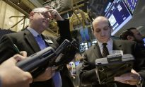 Wall Street Stock Indexes Climb in Morning Trading, GE Gains on Deal News