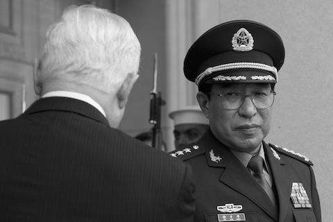 Xu Caihou (R), a formerly powerful general who recently died of bladder cancer. (Jim Watson/AFP/Getty Images)
