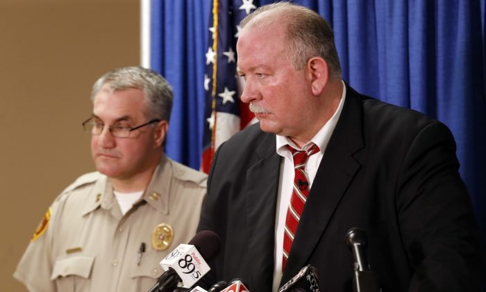 In this Friday, April 10, 2015, photo, Jim Clark, right, an independent consultant, speaks next to Tulsa County Sheriff's Office Capt. Billy McKelvey during a press conference about the investigation of the death of Eric Harris in Tulsa, Okla. Police say a reserve sheriff's deputy thought he was holding a stun gun, not his handgun, when he fatally shot Harris during an arrest that was caught on video in Tulsa. (Cory Young/Tulsa World via AP)