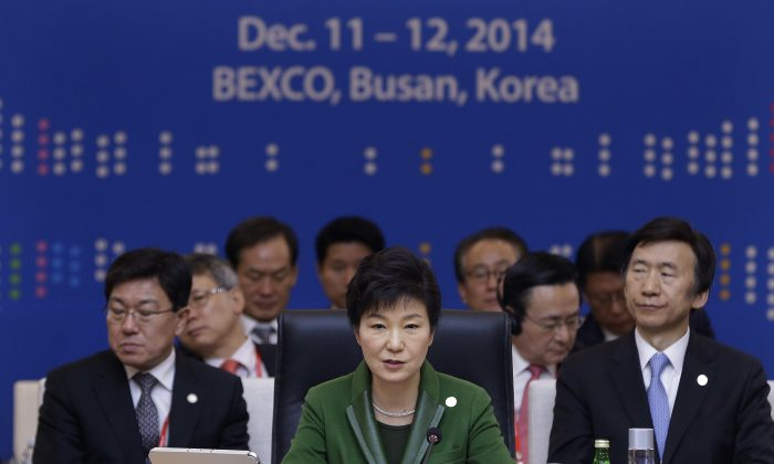South Korea's President Park Geun-hye (C) delivers a statement during the formal session of the ASEAN-Republic of Korea Commemorative Summit in Busan on December 12, 2014. (Ahn Young-Joon/AFP/Getty Images)