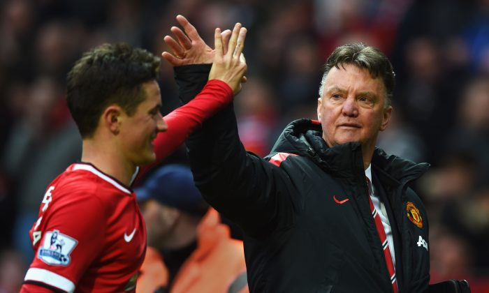 Louis Van Gaal, manager of Manchester United, celebrates victory with his star midfielder Ander Herrera, after the Barclays Premier League match between Manchester United and Manchester City at Old Trafford on April 12th, 2015 in Manchester, England. Herrera has assisted 2, and scored 2 goals in United's last 3 fixtures. (Michael Regan/Getty Images)