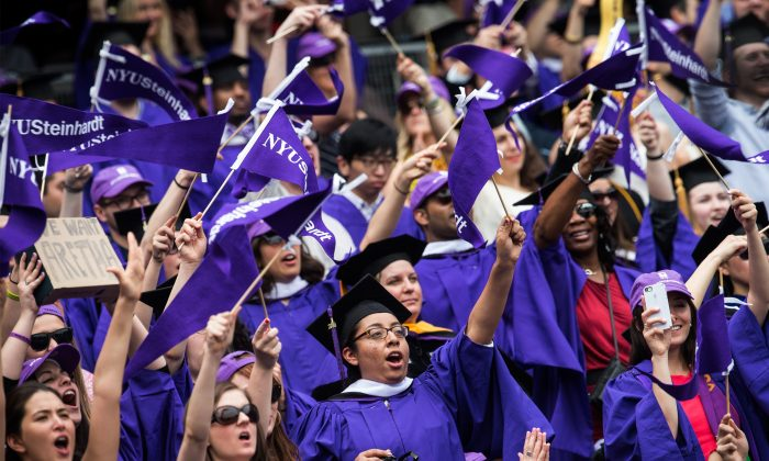 The 2014 New York University graduation ceremony at Yankee Stadium in Bronx, N.Y., on May 21, 2014. (Andrew Burton/Getty Images)