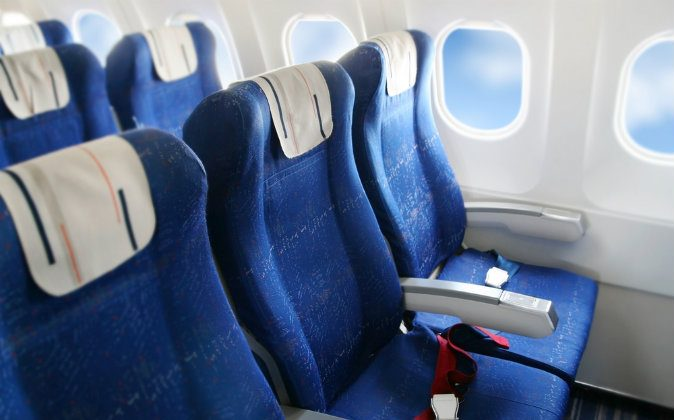 Seat rows in an airplane cabin via Shutterstock*